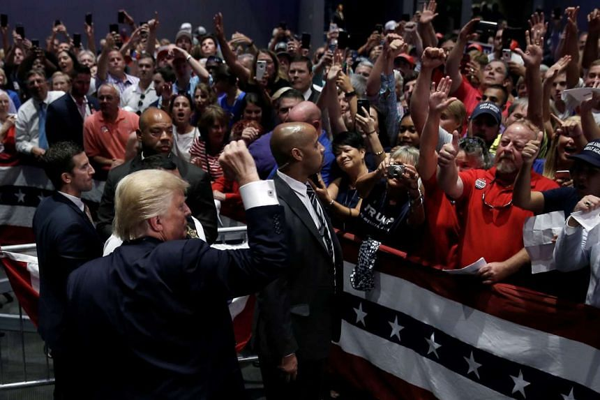 Donald Trump gestures to supporters at a campaign rally in Greenville, North Carolina, on Sept 6, 2016.