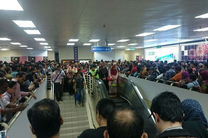 Commuters crowding the platform while waiting for trains to arrive at the Masjid Jamek LRT station in the Malaysian capital of Kuala Lumpur on Sept 8, after a power trip caused a disruption.