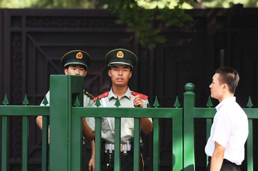 Chinese paramilitary policemen stand outside the entrance to the North Korean embassy in Beijing on Sept 9.