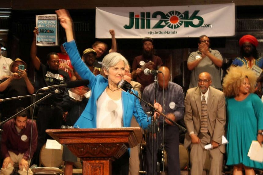 Green Party candidate Jill Stein waves a peace sign after discussing her active arrest warrant in North Dakota at a rally on Sept 8, 2016 in Chicago, Illinois.