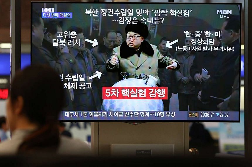 An image of North Korean leader Kim Jong Un is shown on TV at Busan's Grimhae International Airport.