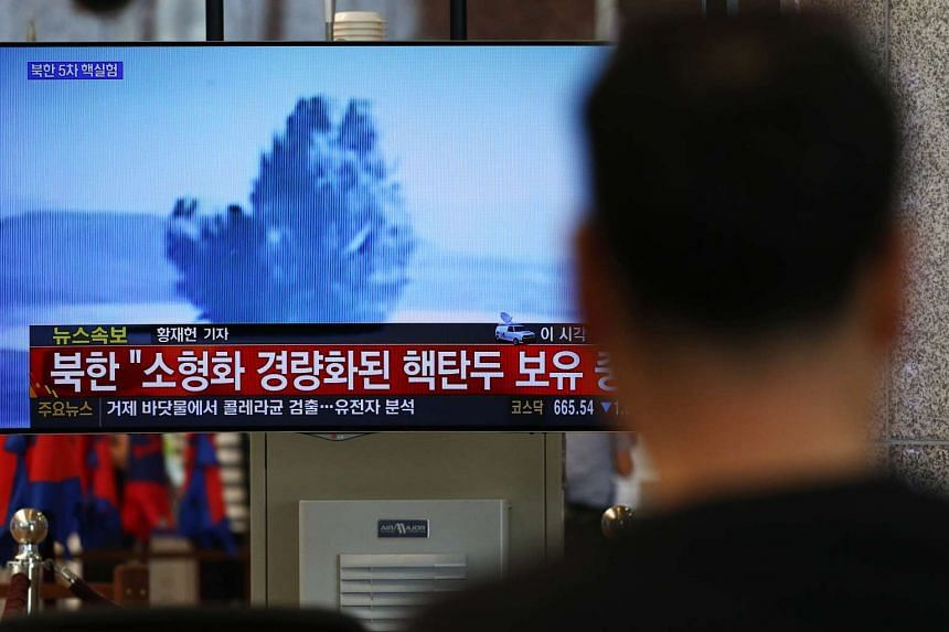 A man watches a television screen showing a news broadcast on North Korea's nuclear test at Gimhae International Airport in Busan, South Korea, on Friday, Sept 9.