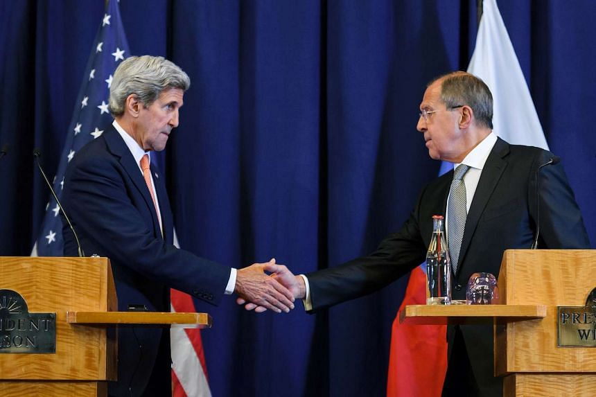 US Secretary of State John Kerry (left) and Russian Foreign Minister Sergei Lavrov shake hands at the end of a press conference.