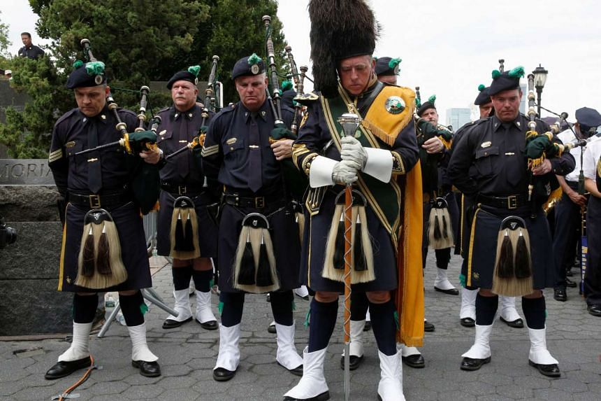 Members of the New York Police Department's (NYPD) Emerald Society Pipe & Drum Band hold a moment of silence to mark the 15th anniversary of the 9/11 attacks in New York City, US, Sept 9.