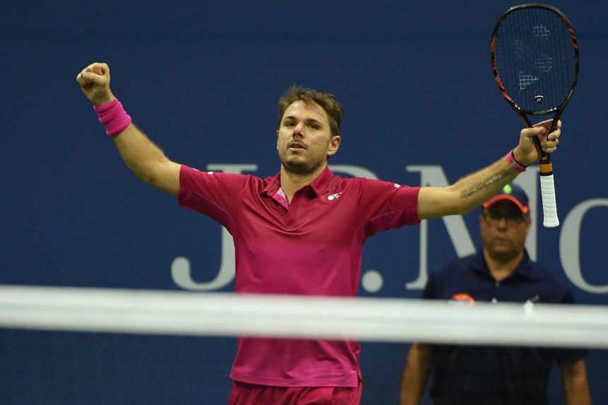 Stan Wawrinka of Switzerland celebrates his victory over Kei Nishikori of Japan during their 2016 US Open men's singles semifinals match at the USTA Billie Jean King National Tennis Center on Sept 9.