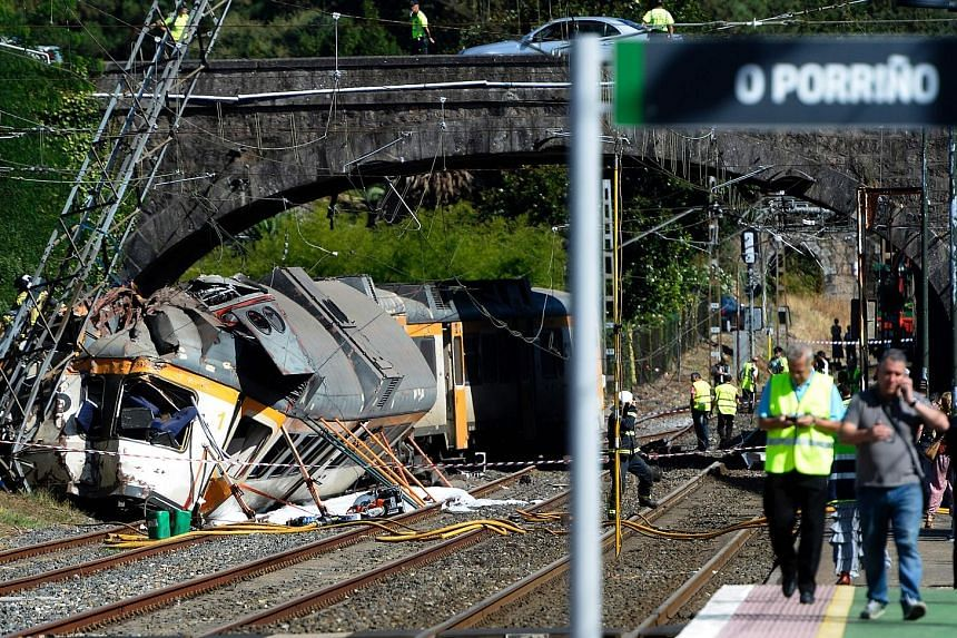 At least four people died and about 50 were injured yesterday when a train with at least 65 people on board went off the tracks in north-western Spain just as it was approaching a station while on its way to Portugal. The Portuguese driver was among