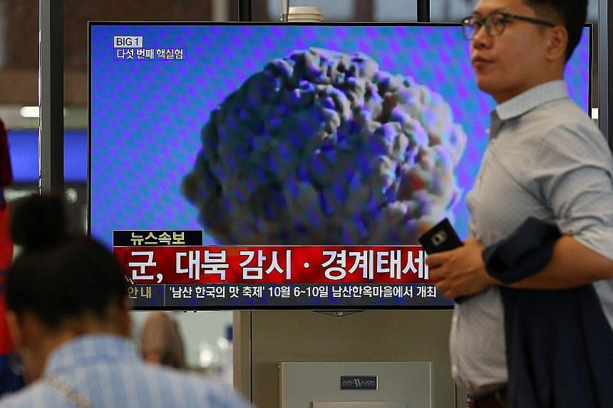A TV news broadcast at Gimhae International Airport in Busan, South Korea, on a powerful nuclear test by North Korea yesterday. A shallow 5.3-magnitude earthquake was detected near North Korea's nuclear test site, pointing to a fifth atomic test. Pyo