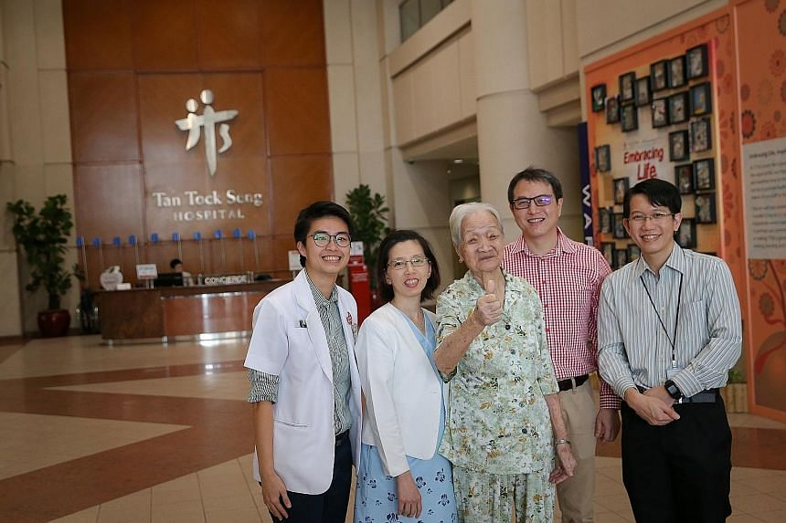 Madam Cheng, 95, with (from left) TTSH's senior dietitian Ong Yawei; nurse clinician Kitty Ho; Dr Jonathan Tan, senior consultant for the department of anaesthesiology and head of the surgical intensive care unit; and Dr Fong Sau Shung, consultant fo