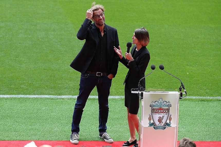 """Liverpool manager Jurgen Klopp being interviewed by a club media official at the opening of Anfield's new Main Stand. The German said the presence of 8,000 more fans in the stadium will bring """"more power"""" against Leicester today."""