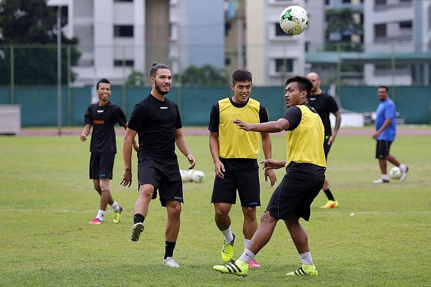 Tampines Rovers' Hafiz Abu Sujad (centre) training with his team-mates yesterday ahead of their game with Home United. The national midfielder is raring to go against the Protectors after playing for the Lions in Bahrain last week.