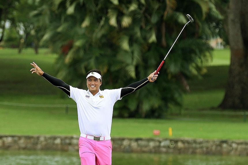 Thailand's Napong Sriparsit celebrating a birdie on the 18th hole on the final day of the Putra Cup yesterday. He carded a three-under 67 for his best round of the four-day tournament, finishing sixth overall in the individual standings.