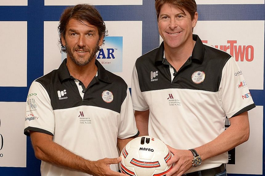 Germany's Karl-Heinz Riedle (left) and England's Darren Anderton will do battle in a Masters friendly match at the National Stadium on Nov 12.