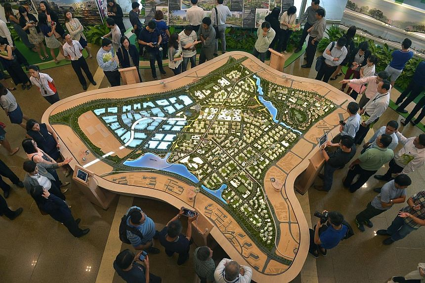 Visitors checking out the Tengah exhibition at the HDB Hub in Toa Payoh yesterday. The first new HDB town since Punggol, Tengah will boast features like a forest corridor, car-free town centre and eco-friendly features.