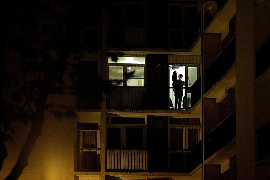 A forensics officer at work inside the building in Boussy-Saint-Antoine, near Paris, where three women were arrested in connection with a car laden with gas cylinders found near Notre Dame Cathedral. The women are suspected of plotting a terror attac