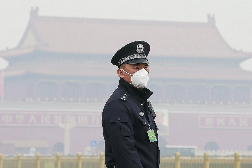 A policeman in Beijing wearing a mask for protection against air pollution in March. The aggregate cost of premature deaths was more than US$5 trillion (S$6.7 trillion) worldwide in 2013.