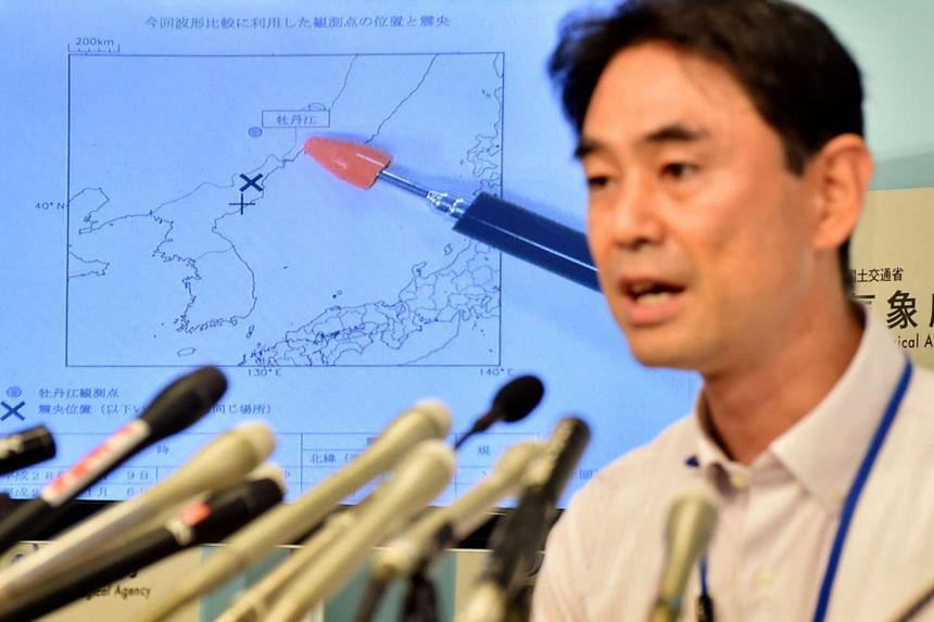 Japan meteorological agency officer Gen Aoki speaks during a press conference following news of the test on Sept 9, 2016.