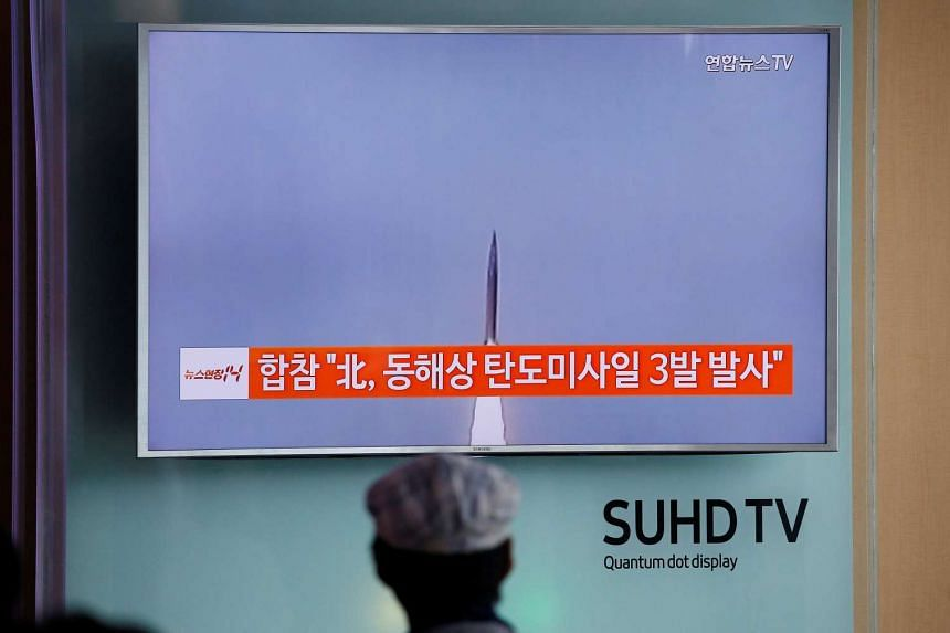 A passenger in Seoul watches a news report on North Korea firing three ballistic missiles into the sea off its east coast on Sept 5, 2016.