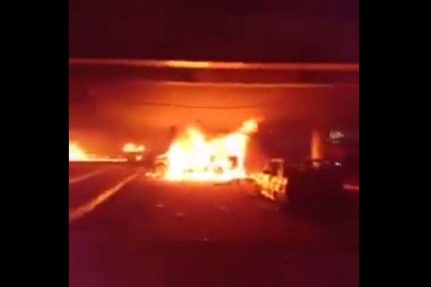 A screenshot of burning cars from a video posted to social media after the attack.