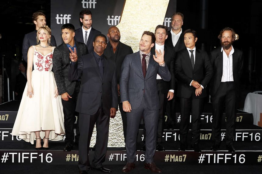 Denzel Washington and Chris Pratt (both in front) with The Magnificent Seven cast at the 41st Toronto International Film Festival in Canada on Thursday.