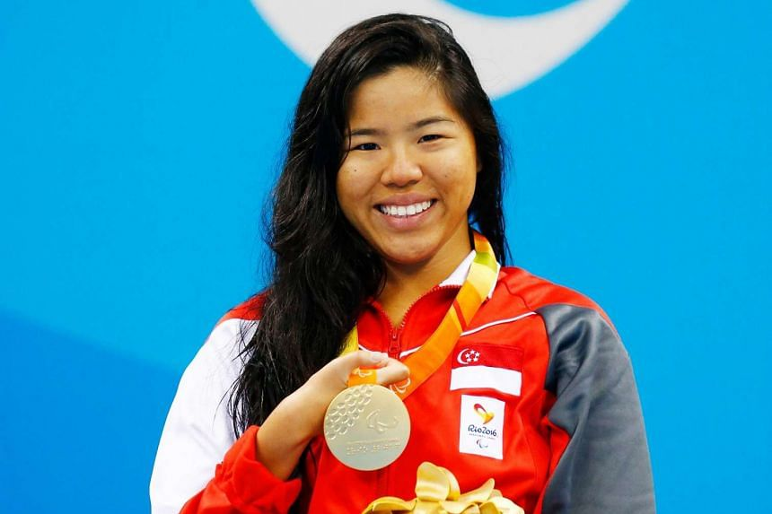 Singapore swimmer Yip Pin Xiu with her gold medal.