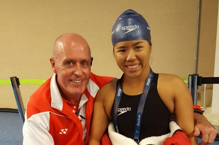 Yip and her coach Mick Massey at the mixed zone area in the Olympic Aquatics Stadium after her race.