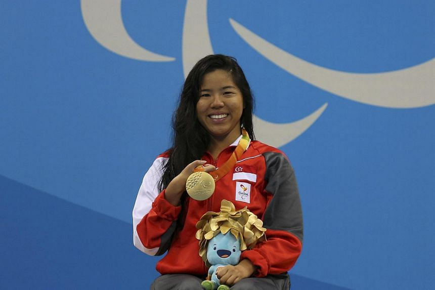 Singapore's Yip Pin Xiu with her gold medal after winning the 100m backstroke S2.