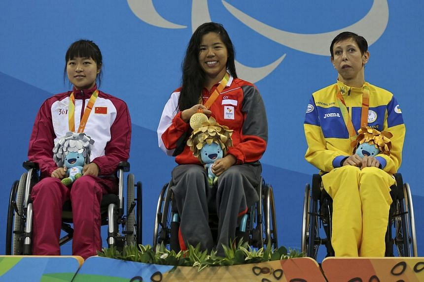 Yip with her fellow medallists Feng Yazhu of China (left) and Ukraine's Iryna Sotska.