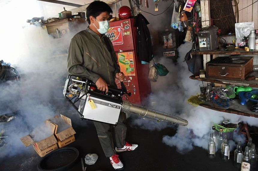 A municipal worker fumigates a residential area against the Aedes aegypti mosquito as a preventive measure against the spread of the dengue fever in Bangkok on Feb 5, 2016.