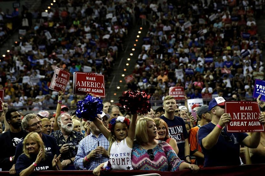 Supporters of Republican presidential nominee Donald Trump cheer at a campaign rally in Pensacola, Florida, US on Sept 9, 2016.