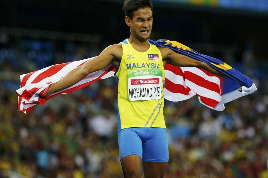 Mohamad Ridzuan Mohamad Puzi of Malaysia celebrates after winning the gold medal in the men's 100m T36 Paralympic final in Rio de Janeiro on Sept 10, 2016.