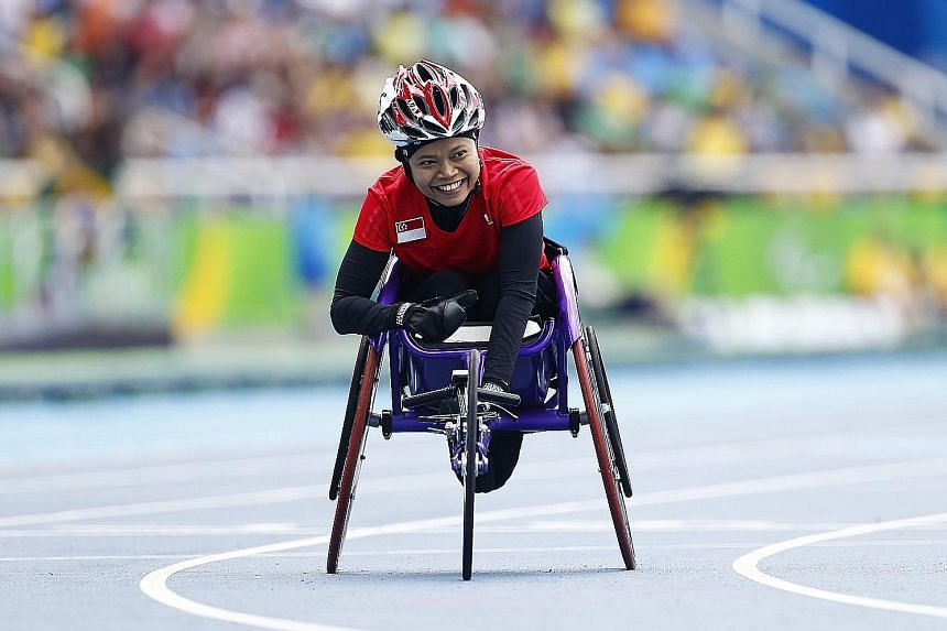 Singapore's Norsilawati Sa'at clocking 1min 49.56sec, her personal best, in the 400m T52 final at the Olympic Stadium in Rio de Janeiro yesterday. The 39-year-old finished fifth out of five competitors in a race won by Michelle Stilwell of Canada in