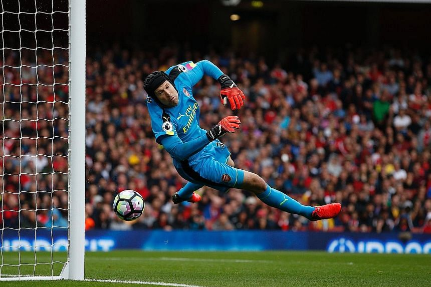 Arsenal goalkeeper Petr Cech was helpless on 18 minutes as the ball rebounded off his back and into the net, after it had hit the bar following a Dusan Tadic free kick. But the hosts hit back with a Laurent Koscielny overhead kick and a stoppage-time