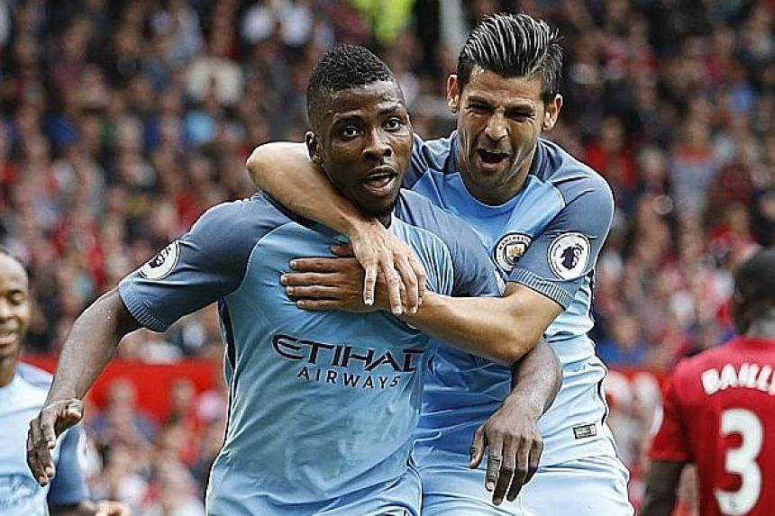 Top: Manchester City's Kelechi Iheanacho (left), celebrating with Nolito, more than filled in for the suspended Sergio Aguero by scoring his side's winner. A crestfallen Jose Mourinho sharing an embrace with old enemy Pep Guardiola (right) after the