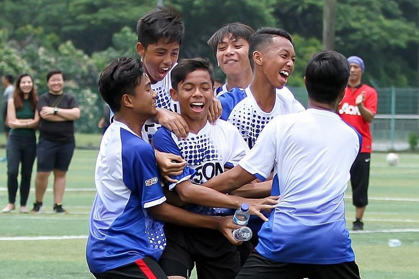 Players from Valentia CF celebrate their penalty shootout victory that won them the inaugural Epson Singapore Cup.