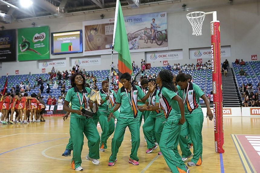 The triumphant Zambia team strutting their stuff on court after capturing the Nations Cup. They beat Papua New Guinea 65-49.