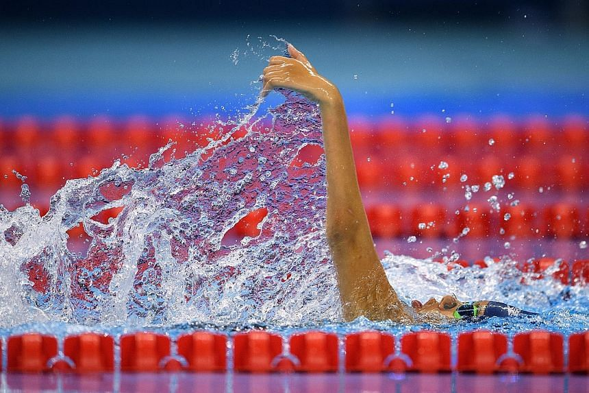 Yip Pin Xiu on her way to clinching gold and shaving 2.7sec off her world record in the 100m backstroke (S2) final at the Olympic Aquatics Stadium in Rio.