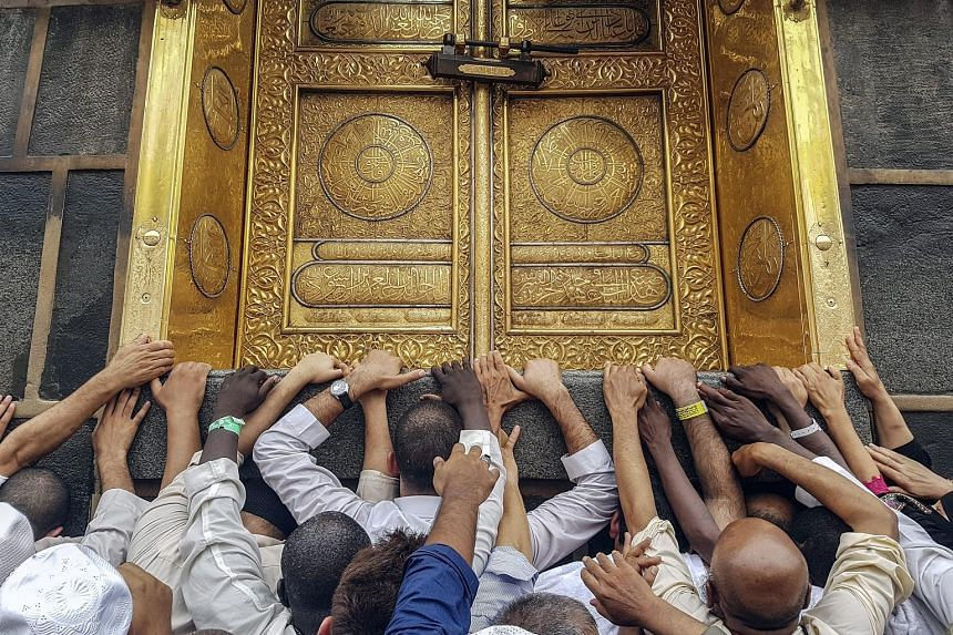 """Muslim pilgrims at the door of the Kaaba, Islam's holiest shrine, in Mecca last Friday. The Saudi authorities say they have put in """"great efforts"""" to ensure pilgrims' safety."""