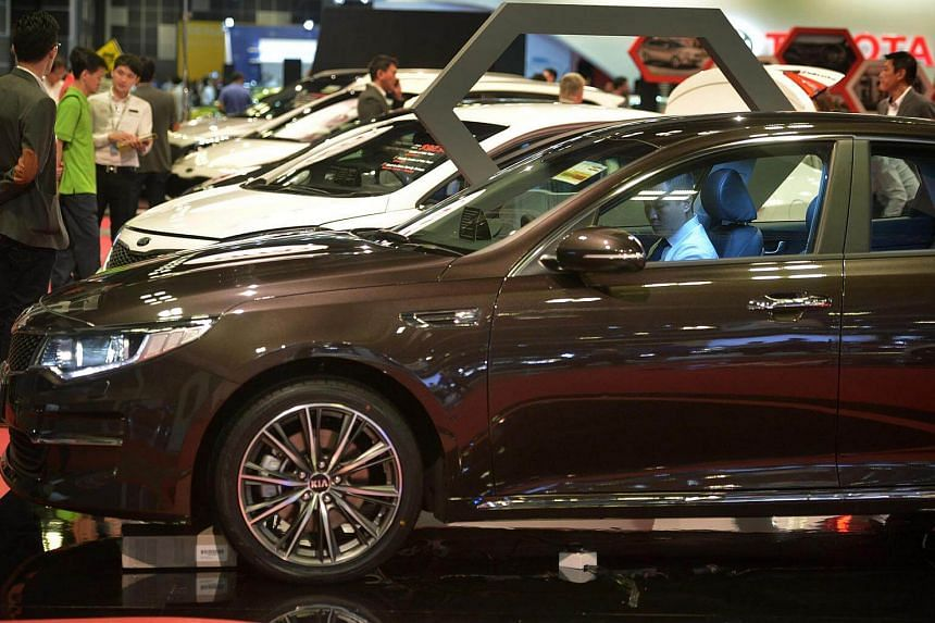 Potential car buyers at the Singapore Motorshow 2016 at Suntec Convention and Exhibition Centre on Jan 14, 2016.