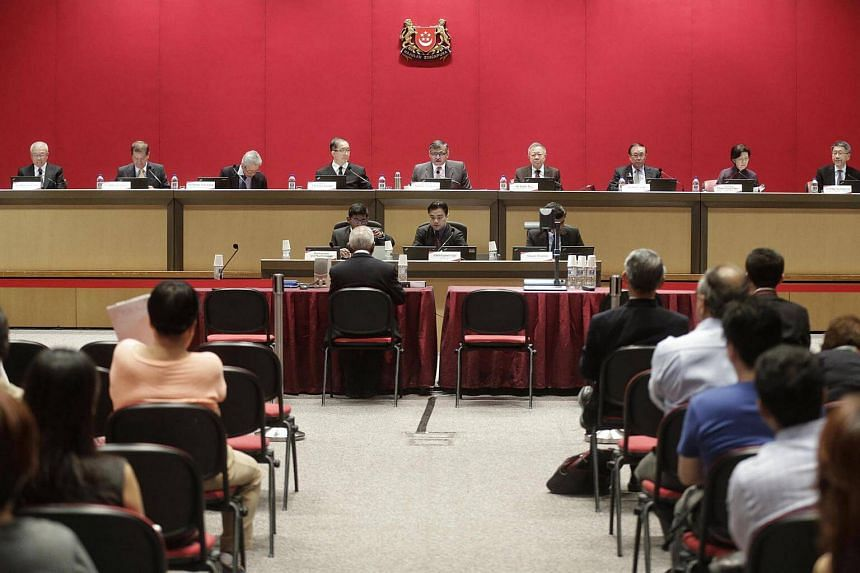 Former Cabinet minister S. Dhanabalan speaking at the Constitutional Commission hearing on elected presidency with (back row, from left) Constitutional Commission members Mr Chua Thian Poh, Mr Abdullah Tarmugi, Mr Wong Ngit Liong, Justice Tay Yong Kw