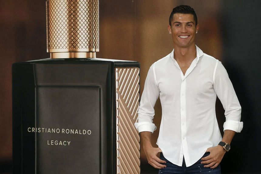 Ronaldo poses for the media during an event to promote his new perfume in Madrid on Sept 8, 2016.