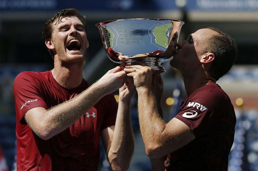 Jamie Murray (left) and Bruno Soares celebrate with the championship trophy.