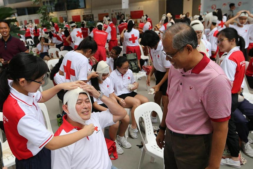 Minister for the Environment and Water Resources Masagos Zulkifli (right) observes a first aid demonstration at Singapore's first psychological first aid training programme yesterday morning (Sept 10) held at Our Tampines Hub.