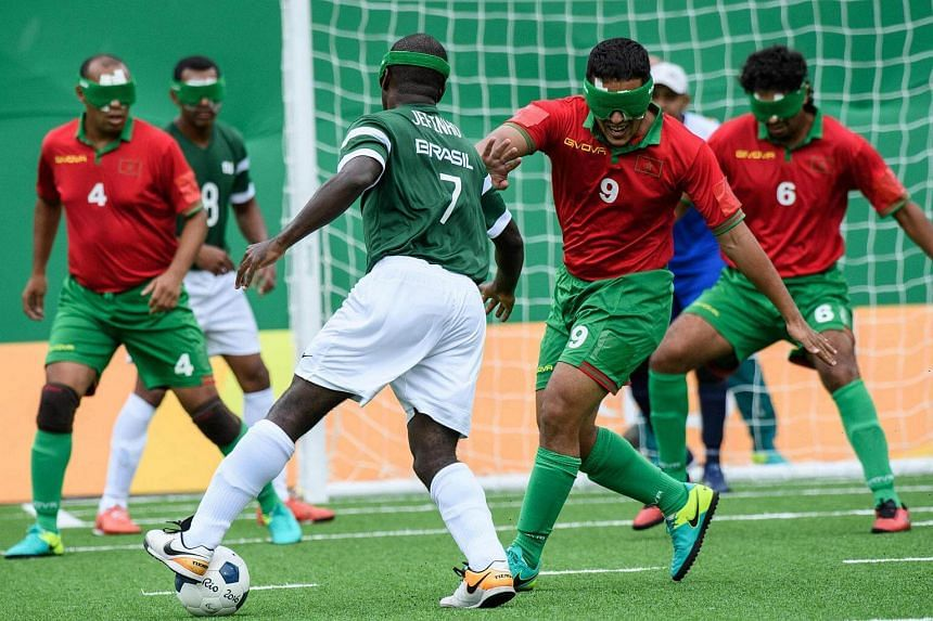Morocco's Othmane Driouch (second, right) tries to stop Brazil's Jefinho (centre) during their men's football 5-a-side match against Brazil during the Rio 2016 Paralympic Games, on Sept 9, 2016.