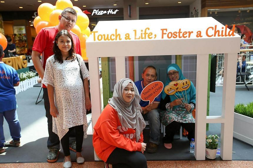 People pose for photos at the inaugural Foster Care Roadshow at Jurong Point on Sept 10.