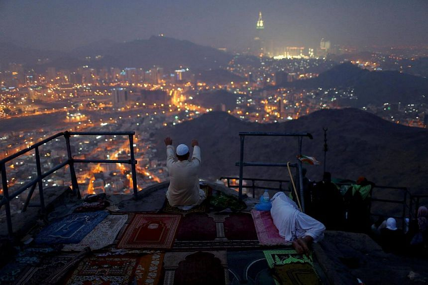 A pilgrim prays at Mount Al-Noor, where Muslims believe Prophet Mohammad received the first words of the Koran through Gabriel in the Hera cave, ahead of the annual haj pilgrimage in the holy city of Mecca, Saudi Arabia on Sept 7, 2016.