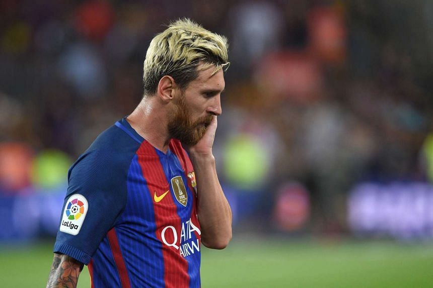 Barcelona's Argentinian forward Lionel Messi leaves the pitch at the end of the match.