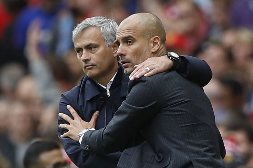 Manchester United manager Jose Mourinho and Manchester City manager Pep Guardiola at the end of the match.
