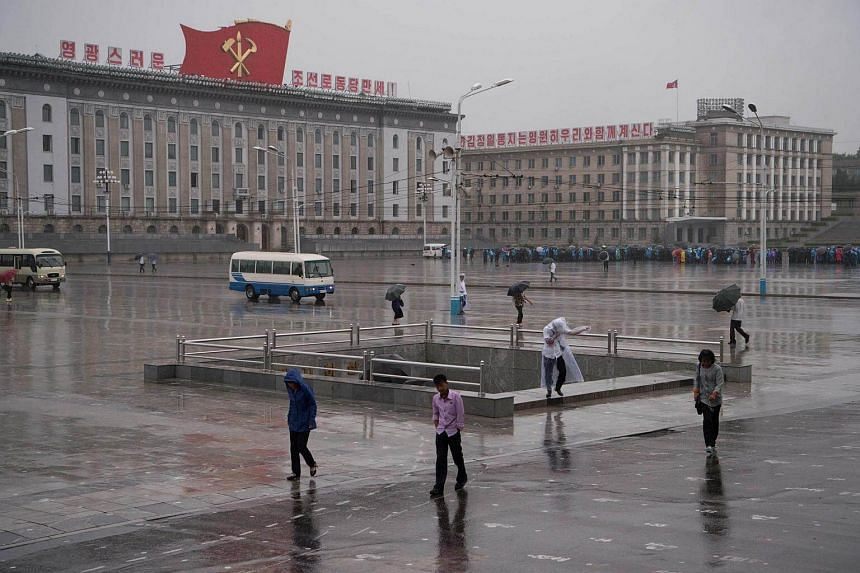A general view shows Kim Il-Sung square during rainfall in Pyongyang on July 16, 2016.