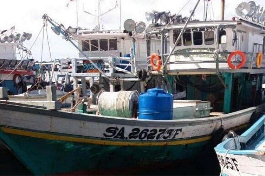 The fishing trawler docked at the Semporna jetty in the east of coast of Sabah. Three fishermen were abducted by gunmen in Sabah waters off the tourist resort of Pulau Pom Pom.