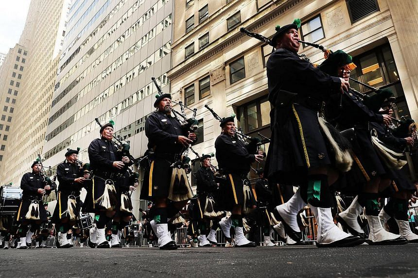 Members of the NYPD Emerald Society Pipes and Drums band march during a procession in Lower Manhattan to mark the 15th anniversary of the 9/11 attacks and the police officers who were killed during and after the event on Sept 9, 2016 in New York City